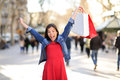 Shopping woman happy on la rambla street barcelona shopper girl holding bags up excited outdoors walking mixed Royalty Free Stock Photos