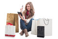 Shopping woman holding credit or debit card and tablet beautiful happy with bags arround her Royalty Free Stock Images