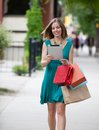 Shopping woman holding digital tablet on street Royalty Free Stock Photo