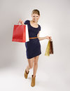 Shopping woman lucky shopper beautiful young blond holding colorful bags Royalty Free Stock Photos