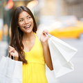 Shopping woman in new york city manhattan usa shopper holding bags walking smiling happy during spree outside Stock Photography