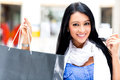 Shopping woman paying by card Royalty Free Stock Image