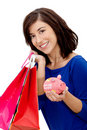 Shopping woman with a piggybank Stock Photos
