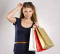 Shopping woman portrait of lovely fresh holding bags beautiful young blonde caucasian model posing in studio Royalty Free Stock Photos