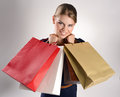 Shopping woman pretty smiling lady with many colorful bags young cheerful blue eyed in studio Stock Photos