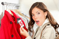 Shopping woman shocked over price Royalty Free Stock Images