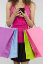 Shopping woman with a smart phone in her hands Royalty Free Stock Photo