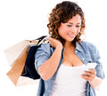 Shopping woman with smart phone using app on a isolated over white Royalty Free Stock Photography