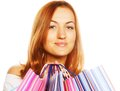 Shopping woman smiling isolated over white background Stock Photography