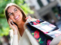 Shopping woman talking on her cell Royalty Free Stock Photo