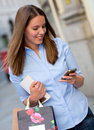Shopping woman texting Stock Photos