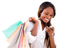 Shopping woman texting on her phone happy cell isolated over white Stock Images