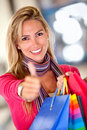 Shopping woman with thumbs up Royalty Free Stock Images