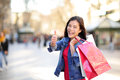 Shopping woman thumbs up on la rambla barcelona spain happy shopper girl holding bags excited outside walking Royalty Free Stock Image
