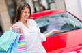 Shopping woman winning a car Royalty Free Stock Photo