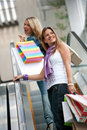 Shopping women on escalators Stock Photos