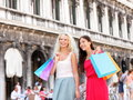 Shopping women girl shoppers with bags venice holding in portrait of beautiful girlfriends smiling happy together having fun Stock Images