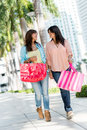 Shopping women in miami happy walking the streets of with bags Royalty Free Stock Photo