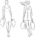Shopping women vector illustration of with bags Stock Photography