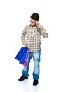Shopping young man with bags isolated on white Stock Photography