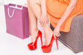 Shopping young woman trying on high heel shoes Royalty Free Stock Images