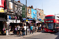 Shops in camden town in london tourists and locals walk on august is s most popular open air market area with stalls Stock Photo