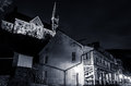 Shops and historic buildings on shenandoah street at night in harper s ferry wv st peter roman catholic church west virginia Stock Photo