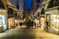 Shops and people along rialto bridge venice italy th march a view of streets at night the blur of can be seen Royalty Free Stock Photography