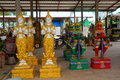Shops statues the giant statue and deities belief in literary is handmade by locals selling to tourists located at nakhon Stock Photo