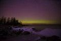 Shore of Ladoga lake and Aurora borealis. Pyatirechye, Leningrad region. Russia Royalty Free Stock Photo