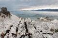 Shoreline of limestone slabs kaikoura new zealand Stock Photo