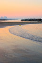 Shoreline at sunset with calm sea Royalty Free Stock Photography