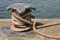 Shoreside bitt with nylon rope Royalty Free Stock Photos