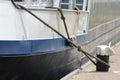Shoreside bitt with nylon rope Royalty Free Stock Photo
