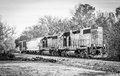 Short train csx diesel locomotive black and white a de saturated picture of a two car as it is just about to enter or pass through Royalty Free Stock Photos