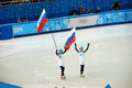 Short trek speed skating russian winners with flags at xxii winter olympic games sochi russia Stock Image