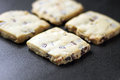 Shortbread biscuits four freshly baked on black with belgium chocolate chips Stock Photos