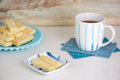 Shortbread biscuits and tea delicious homemade on a couple of blue plates a cup of for afternoon Stock Images