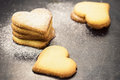 Shortbread cookies in shape of heart as symbol love over gray background Stock Photos