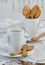 Shortbread and a cup of coffee on wooden background Stock Photos