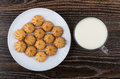 Shortbread in white plate and cup of milk on table Royalty Free Stock Photo
