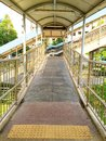 Shortcut road a to footbridge Stock Photography