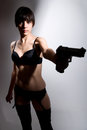 Shot of a beautiful girl holding gun Royalty Free Stock Image