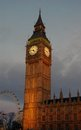 A shot of big ben at dusk with a moody sky and the london eye in the background Stock Photo