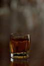 Shot of bourbon closeup a glass full served on a bar top Royalty Free Stock Photo