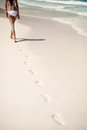 Shot of footprints with woman walks on the tropical beach white Stock Photo