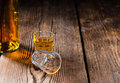 Shot glass with whiskey close up on wooden background Stock Photo