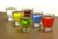 Shot glasses of alcoholic small beverages shallow dof Stock Photos