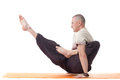 Shot of muscular man posing in difficult asana Royalty Free Stock Photos