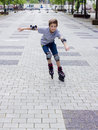 Shot of smiling sliding rollerskater in protection kit Royalty Free Stock Images